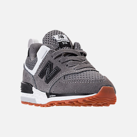 Three Quarter view of Boys' Toddler New Balance 574 Sport Casual Shoes in Castlerock/Black