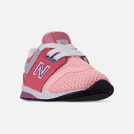 Three Quarter view of Girls' Toddler New Balance 247 Casual Shoes in Himalayan Pink/Pink/White