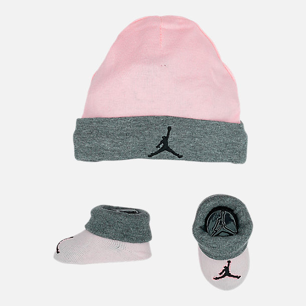 Front view of Infant Nike Hat and Bootie Set in Pink/Grey
