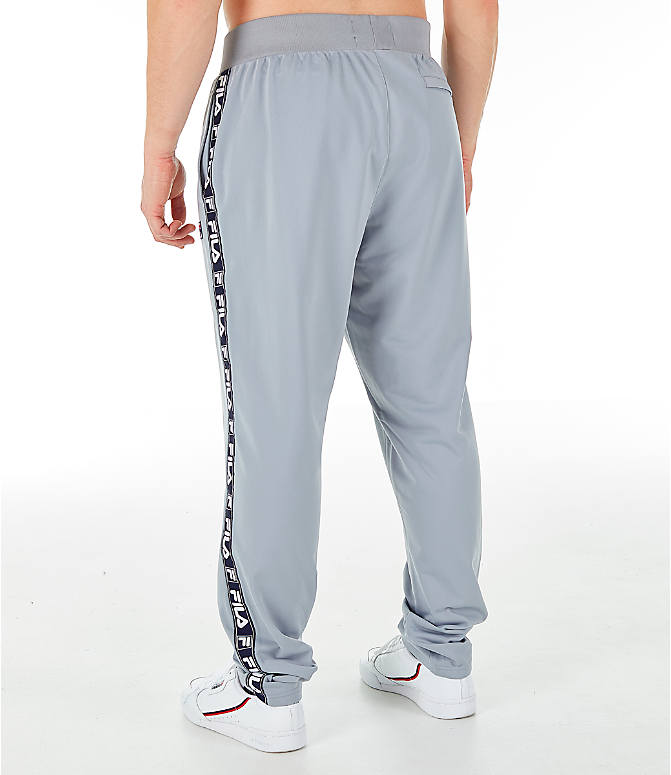 Back Left view of Men's FILA Tag Tricot Track Pants in Silver
