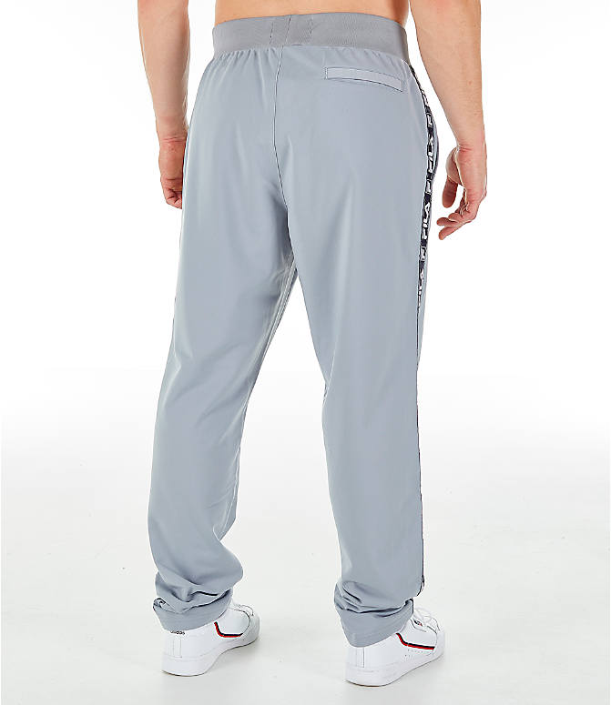 Back Right view of Men's FILA Tag Tricot Track Pants in Silver