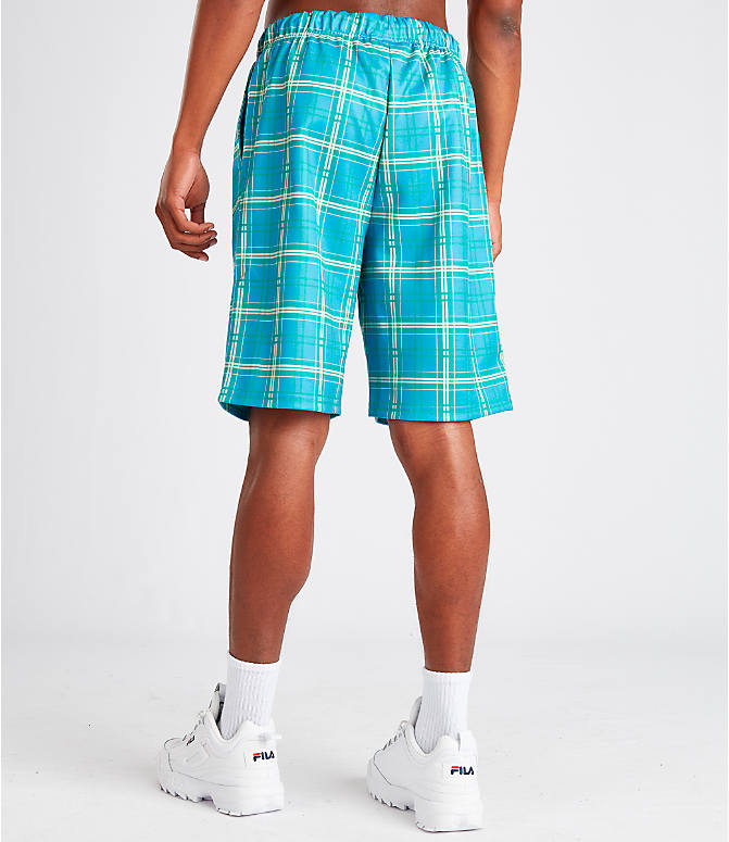 Back Left view of Men's Fila Buzz Shorts in Blue Plaid