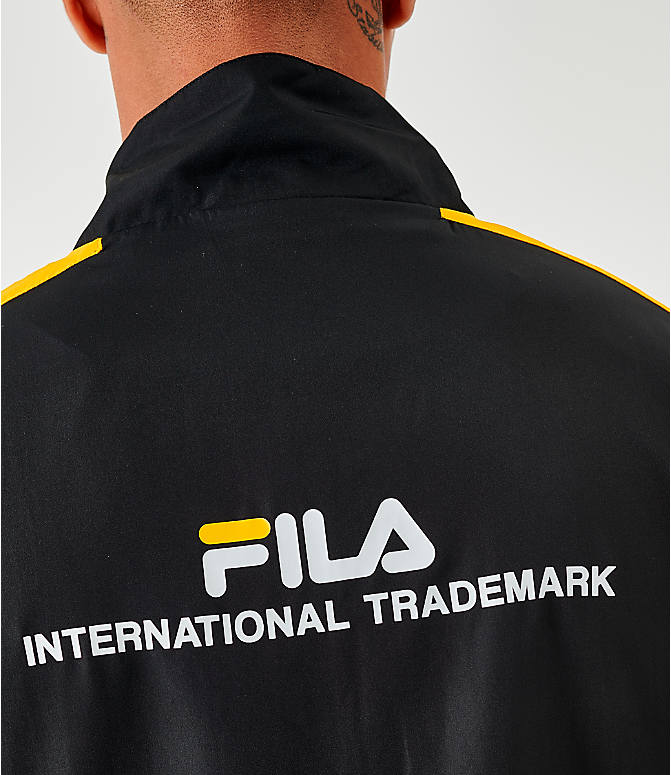 On Model 5 view of Men's Fila Oliviero Woven Track Jacket in Black/White/Yellow