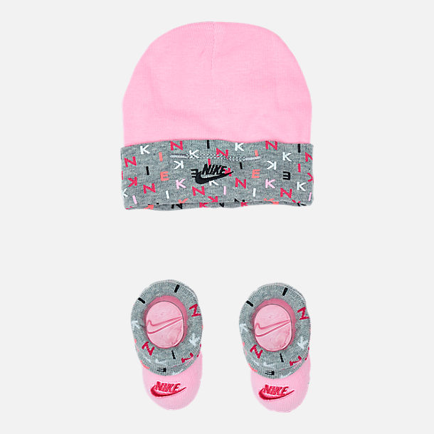 Front view of Infant Nike Allover Print Hat and Bootie Set in Rush Pink/Dark Grey