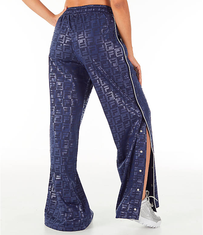 Back Right view of Women's Fila Lena Tear Away Pants in Blue