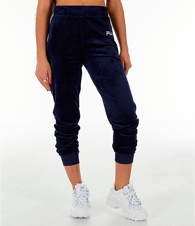 Front Three Quarter view of Women's Fila Sara Velour Jogger Pants in Navy