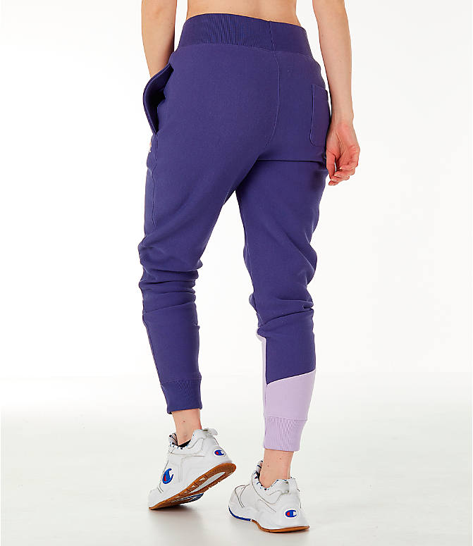 Back Left view of Women's Champion Reverse Weave Varsity Jogger Pants in Blue Violet