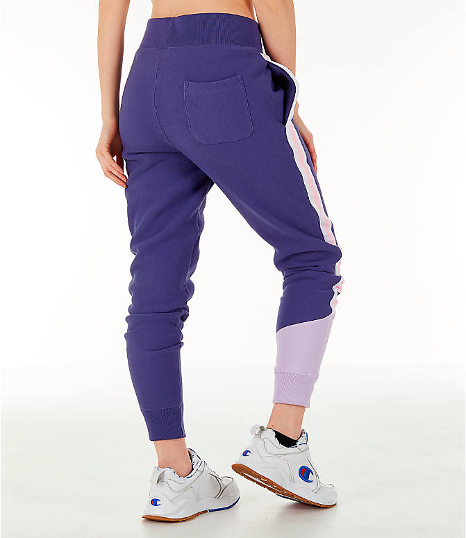 Back Right view of Women's Champion Reverse Weave Varsity Jogger Pants in Blue Violet