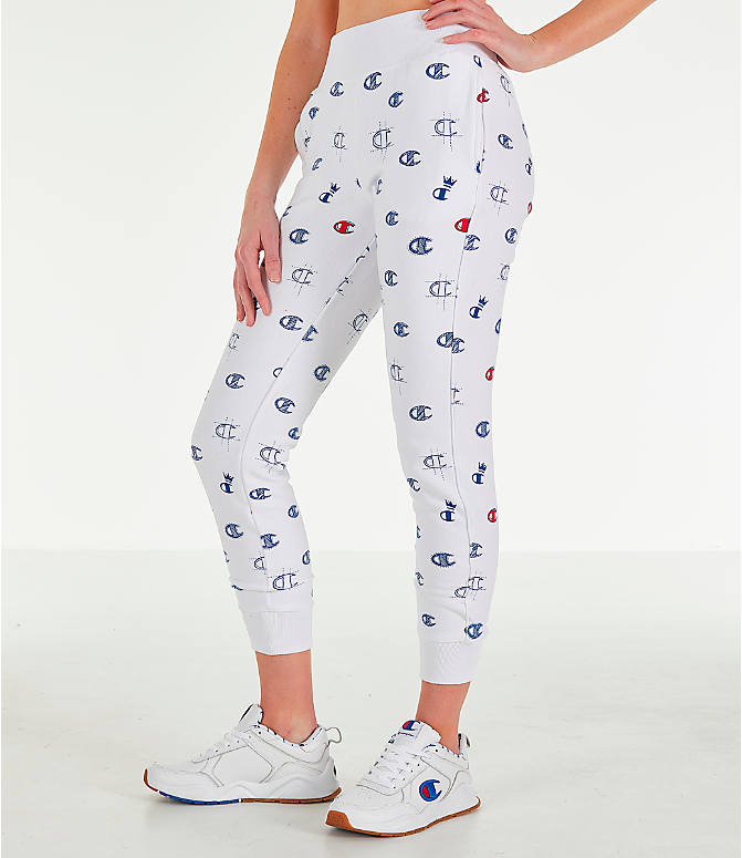Front Three Quarter view of Women's Champion Reverse Weave Allover Print Jogger Pants in White/Red/Blue