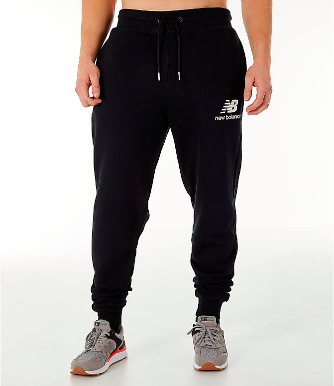 Front Three Quarter view of Men's New Balance Essentials Brushed Sweatpants in Black