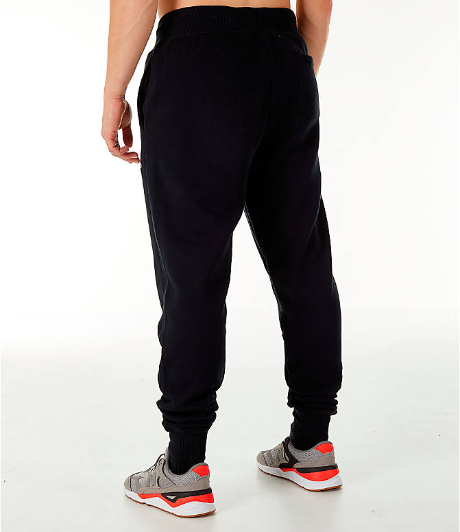 Back Left view of Men's New Balance Essentials Brushed Sweatpants in Black