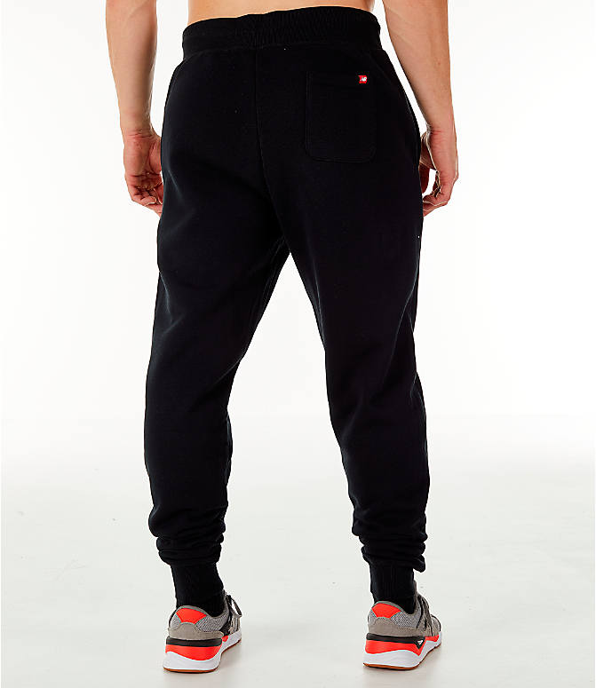 Back Right view of Men's New Balance Essentials Brushed Sweatpants in Black