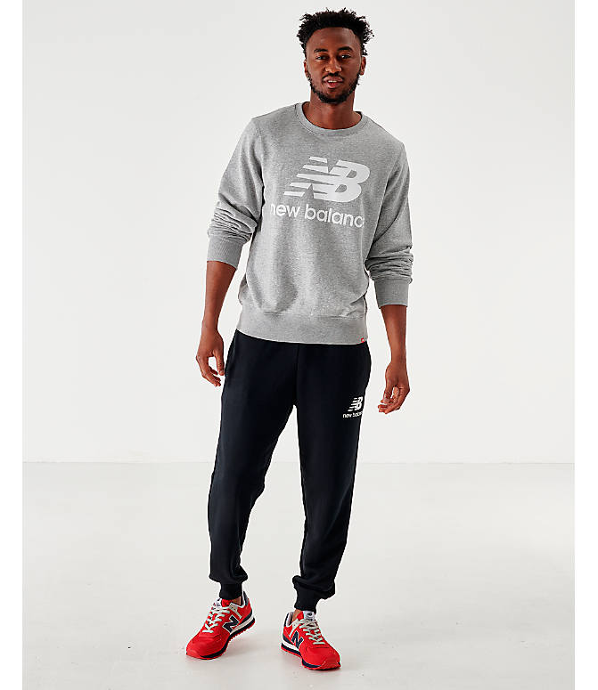 Front Three Quarter view of Men's New Balance Essentials Stacked Logo Crewneck Sweatshirt in Grey