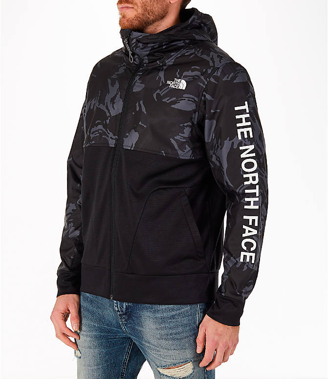 Front Three Quarter view of Men's The North Face Train N Logo Full-Zip Hoodie in Black Tonal Camo/Black