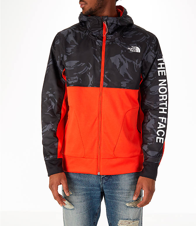 Front view of Men's The North Face Train N Logo Full-Zip Hoodie in Orange/Black