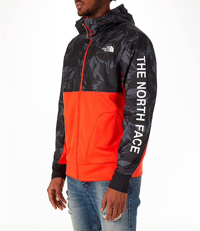 Front Three Quarter view of Men's The North Face Train N Logo Full-Zip Hoodie in Orange/Black