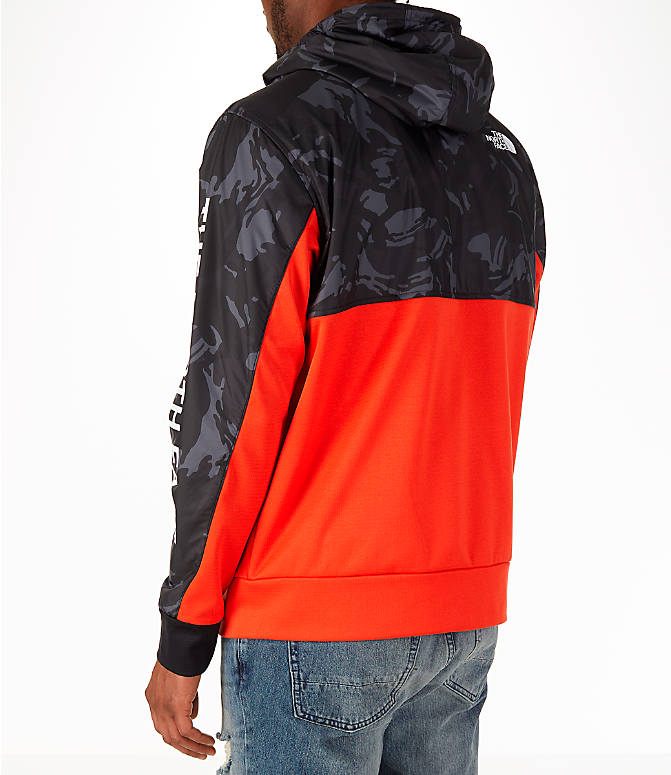 Back Left view of Men's The North Face Train N Logo Full-Zip Hoodie in Orange/Black