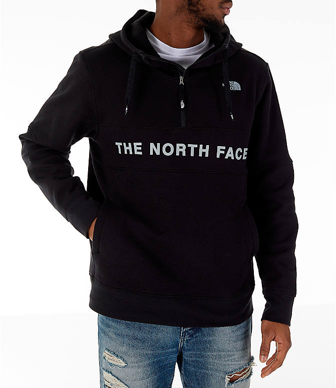 Front view of Men's The North Face Train N Logo Half-Zip Hoodie in Black