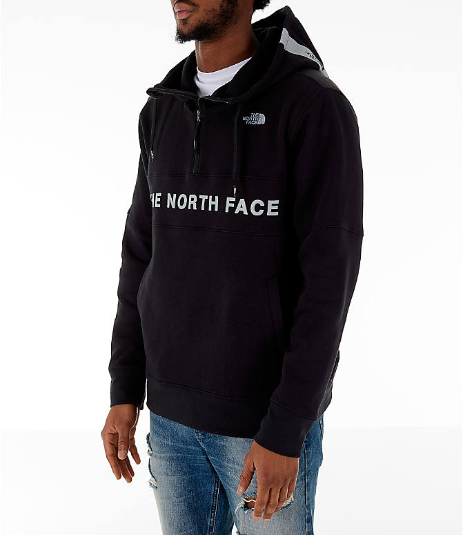 Front Three Quarter view of Men's The North Face Train N Logo Half-Zip Hoodie in Black