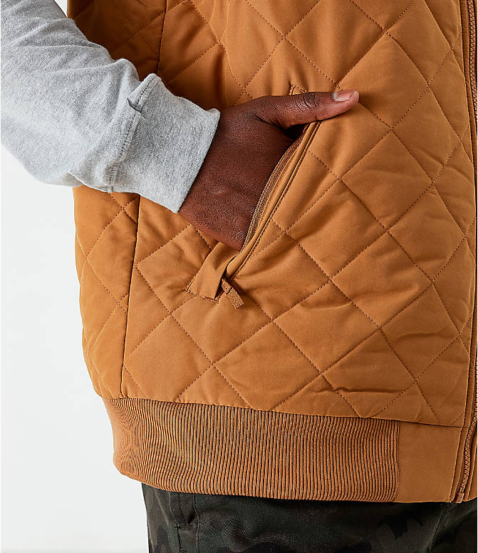 On Model 5 view of Men's The North Face Cuchillo Insulated Vest in Cedar Brown