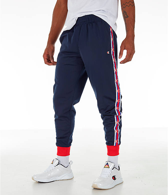 Front view of Men's Champion Side Tape Track Jogger Pants in Indigo/Scarlet