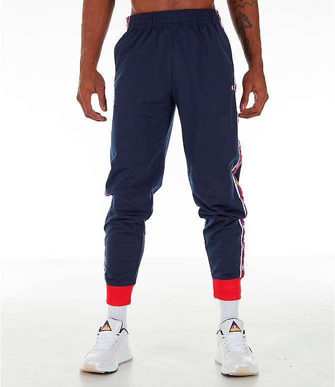 Front Three Quarter view of Men's Champion Side Tape Track Jogger Pants in Indigo/Scarlet