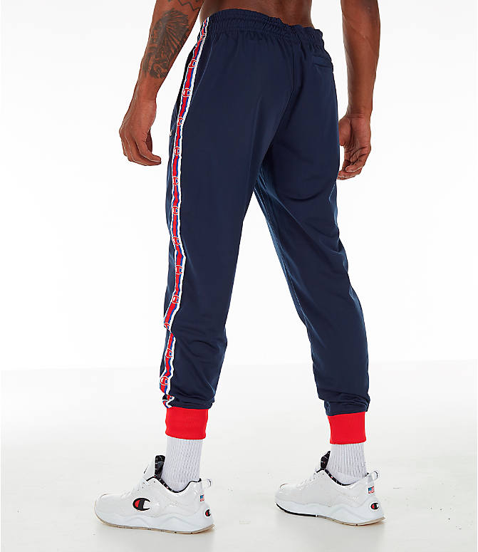 Back Left view of Men's Champion Side Tape Track Jogger Pants in Indigo/Scarlet