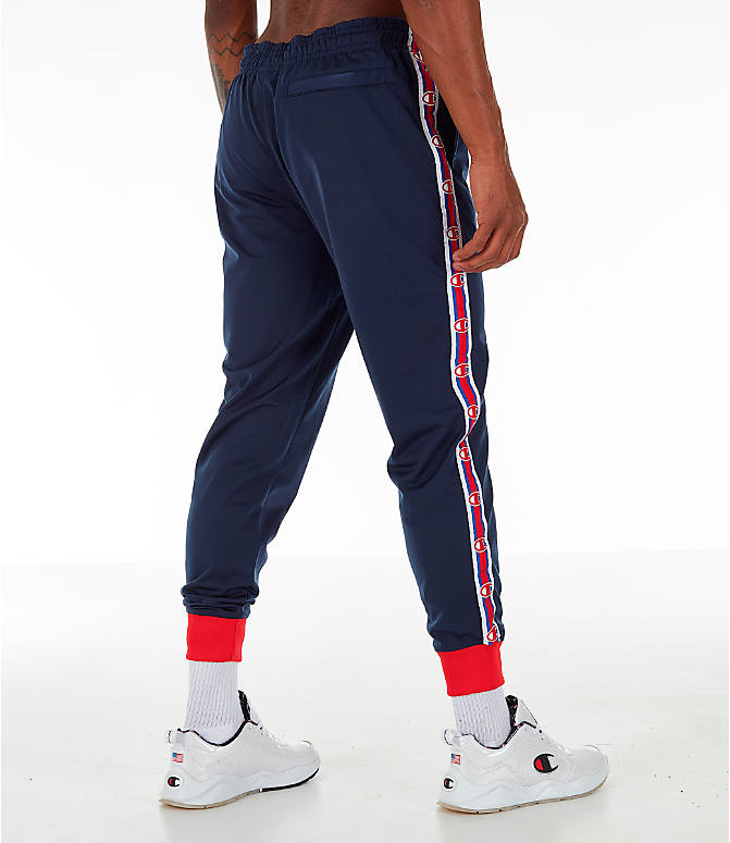 Back Right view of Men's Champion Side Tape Track Jogger Pants in Indigo/Scarlet