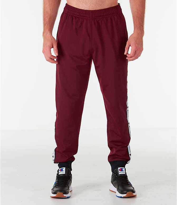 Front Three Quarter view of Men's Champion Side Tape Track Jogger Pants in Mulled Berry