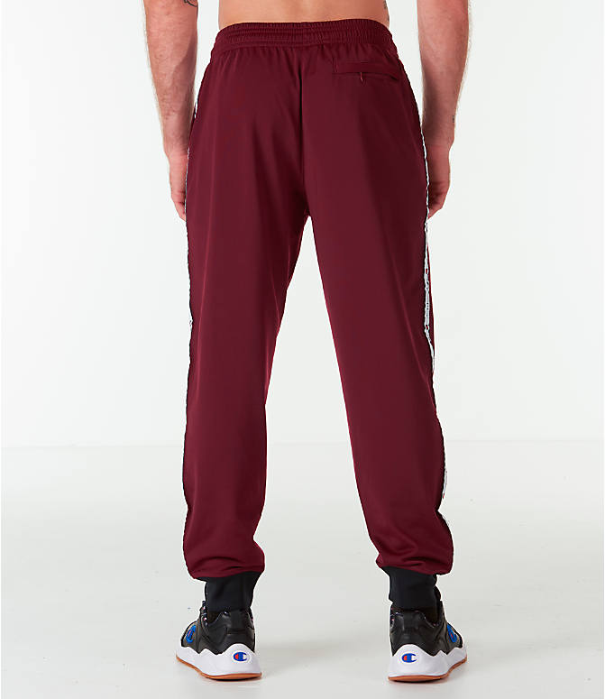 Back Right view of Men's Champion Side Tape Track Jogger Pants in Mulled Berry