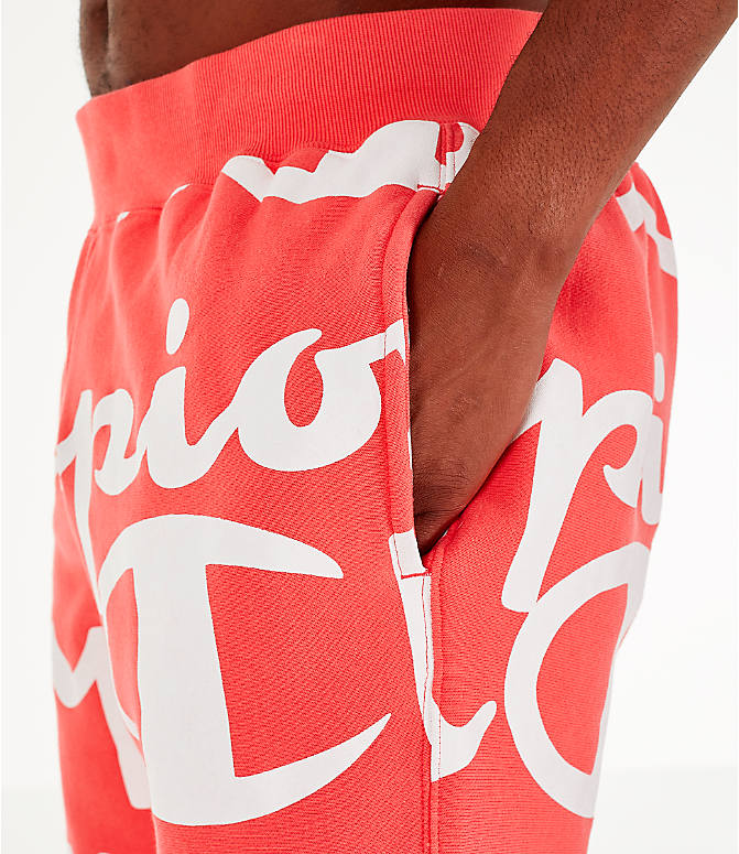 Detail 1 view of Men's Champion Reverse Weave Allover Print Large Script Jogger Pants in Groovy Papaya