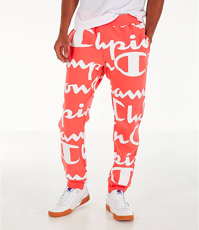 Front view of Men's Champion Reverse Weave Allover Print Large Script Jogger Pants in Groovy Papaya