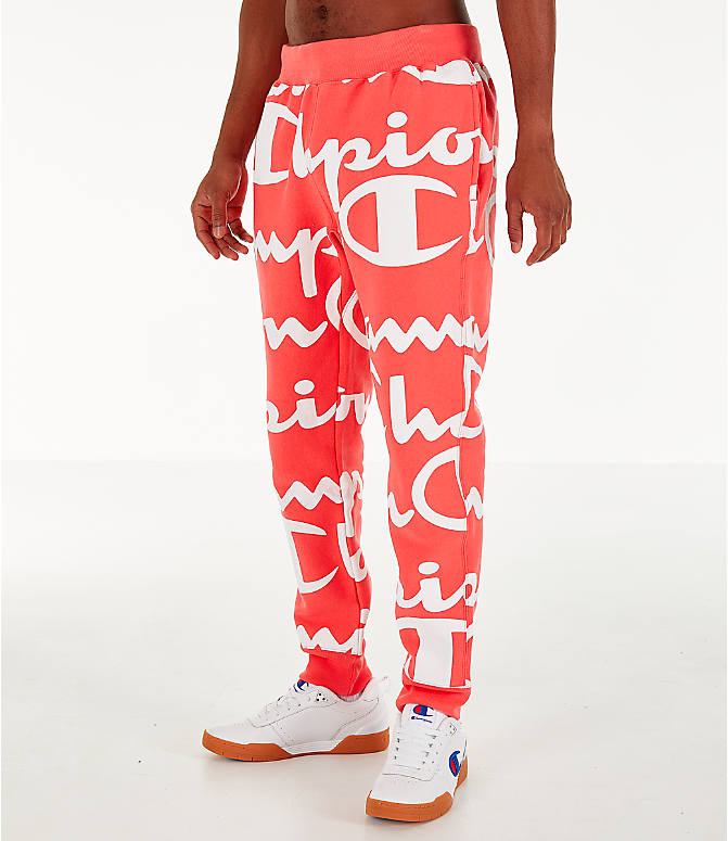 Front Three Quarter view of Men's Champion Reverse Weave Allover Print Large Script Jogger Pants in Groovy Papaya