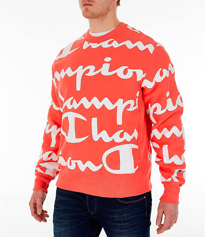Front Three Quarter view of Men's Champion Reverse Weave Allover Print Large Script Crewneck Sweatshirt in Groovy Papaya