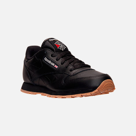 Three Quarter view of Kids' Grade School Reebok Classic Leather Casual Shoes in Black/Gum
