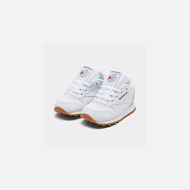 Three Quarter view of Kids' Toddler Reebok Classic Leather Casual Shoes in White/Gum
