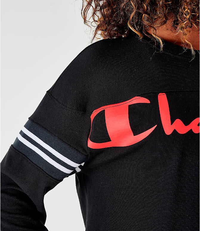 On Model 5 view of Women's Champion Life Heavyweight Jersey Script Logo Exaggerated Sleeve T-Shirt in Black/Red/White