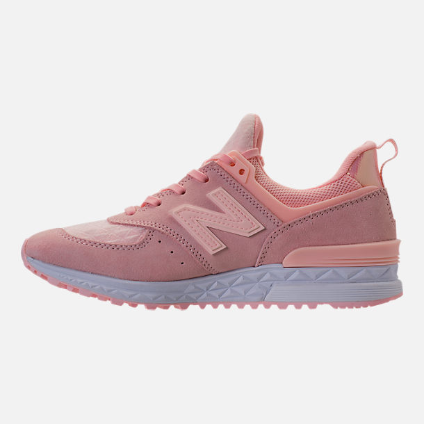 Left view of Women's New Balance 574 Sport Casual Shoes in Sunrise Glo/White
