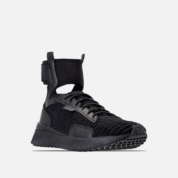 Three Quarter view of Women's Puma x Rihanna Fenty Trainer Mid Casual Shoes in Black