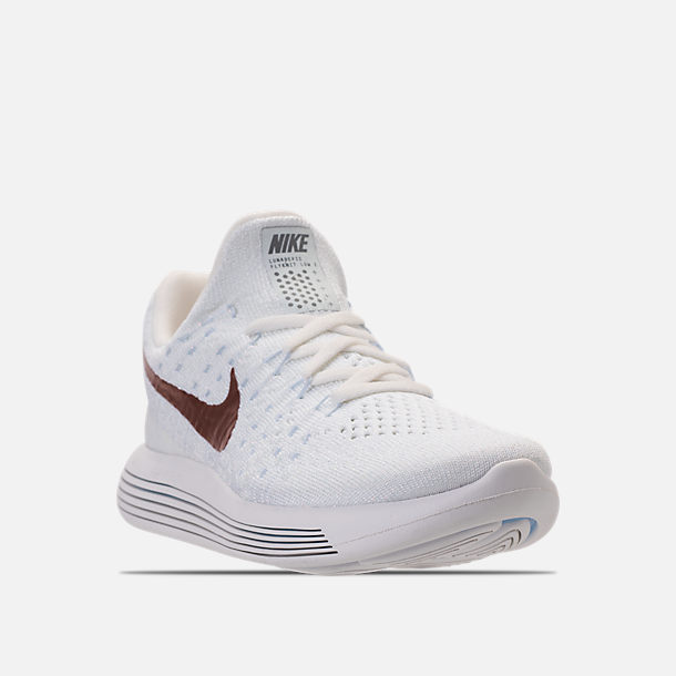 315e66be575 Three Quarter view of Women s Nike LunarEpic Low Flyknit 2 Running Shoes in  White Metallic