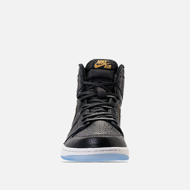 Front view of Men's Air Jordan Retro 1 High Basketball Shoes in Black/Metallic Gold/Summit White